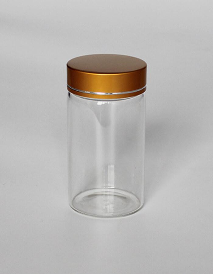 ظرف شیشه ای مخصوص بسته بندی زعفران با درب طلایی و جنش آلومینیوم